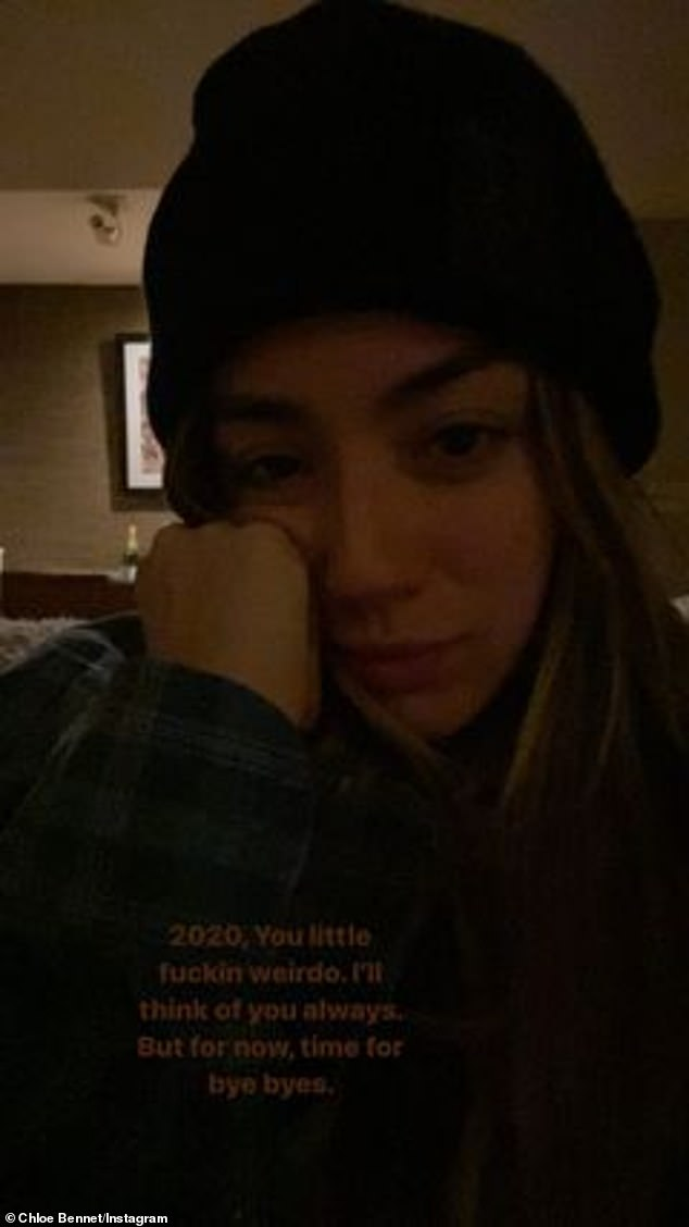 Push through: Additionally, the beauty also took part in a photo shoot of herself in a beanie and looking tired as she pressed one hand to her cheek and described 2020 as a `` A little bit cranky?