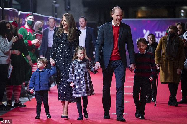 It is believed that Cambridge intended to return to its base in London at Kensington Palace, but it now has no reason to return to the capital, and the law advises against essential travel.  Pictured with their children attending a special mumming show at the Palladium in London in December
