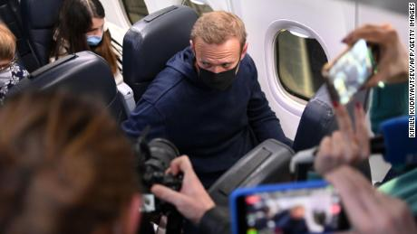 Russian opposition leader Alexei Navalny in a Pobeda plane after landing at Sheremetyevo Airport in Moscow on January 17, 2021.