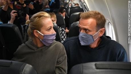 Russian opposition leader Alexei Navalny, right, and his wife Yulia Navalnya, aboard an airline's Pobeda plane bound for Moscow before taking off from Berlin on Sunday.