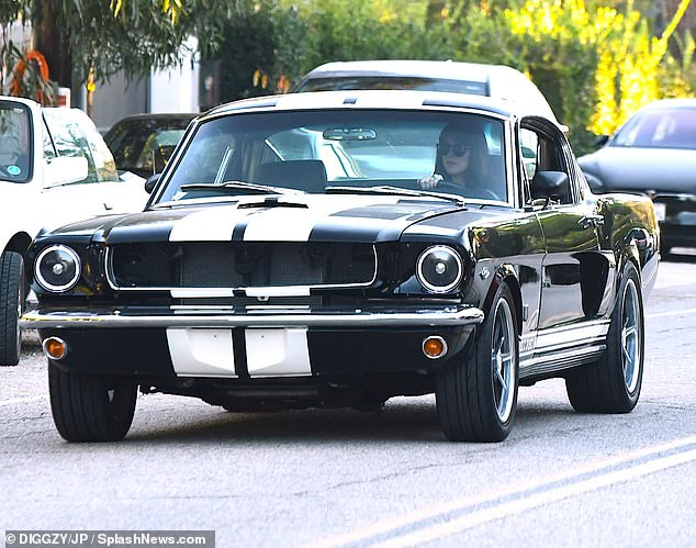 Wheels: The 31-year-old was spotted at the wheel of her Vintage Shelby GT350 Mustang as she stopped at a friend's house