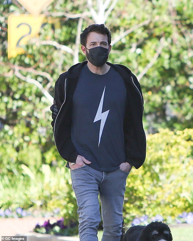Solo: Ben, 48, is pictured here on January 9 walking his dog.  The actor has not photographed with Anna since November 2020