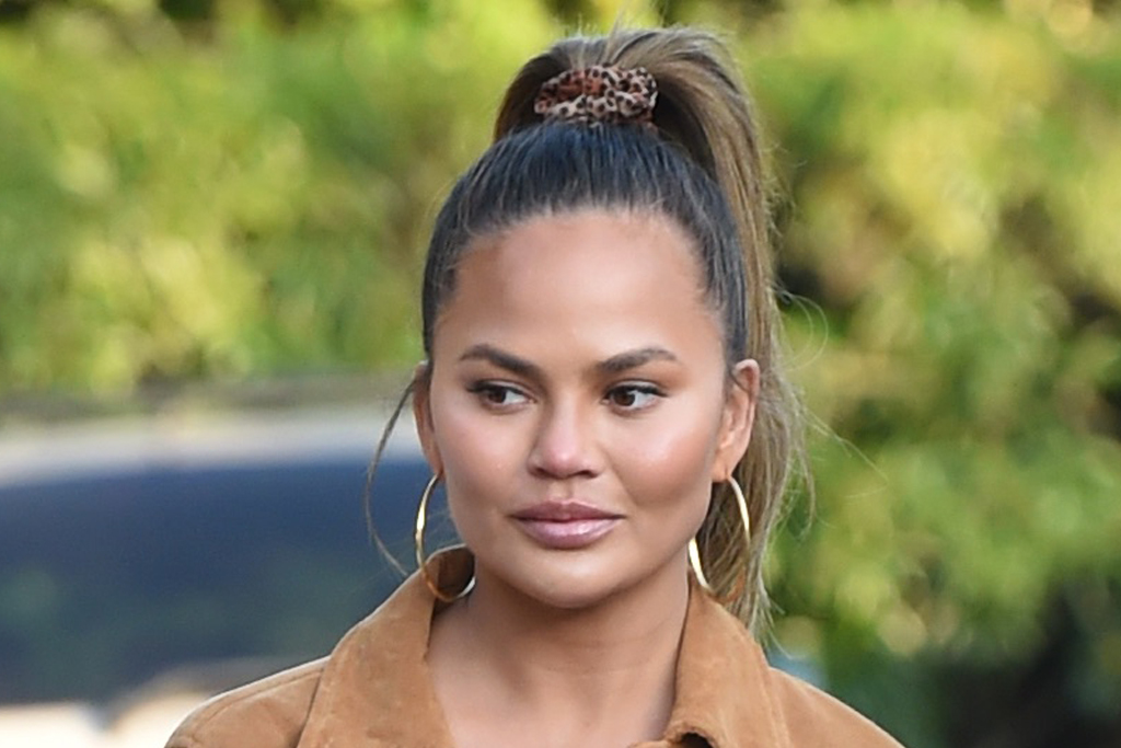 Chrissy Teigen celebrates Inauguration Day with Fire-Red Bottega pumps – shoe news