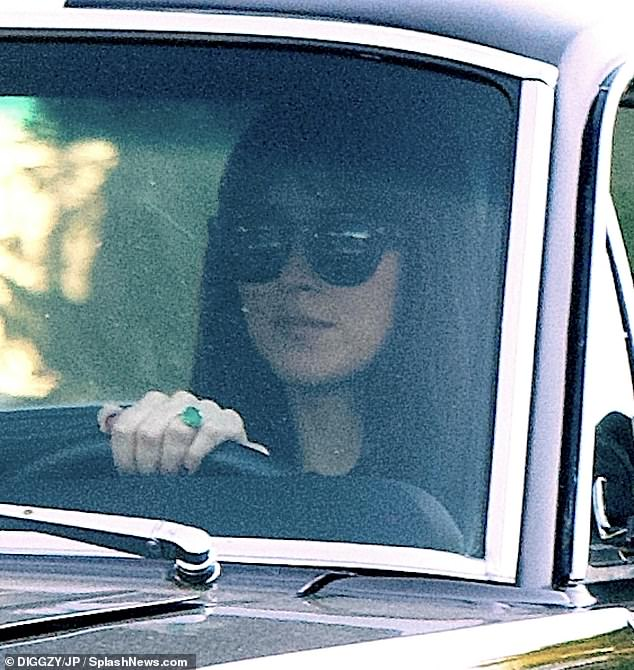 To be a bride?  Dakota Johnson went on tour on Saturday and threw a huge emerald ring on her hand amid rumors of her engagement to Chris Martin.