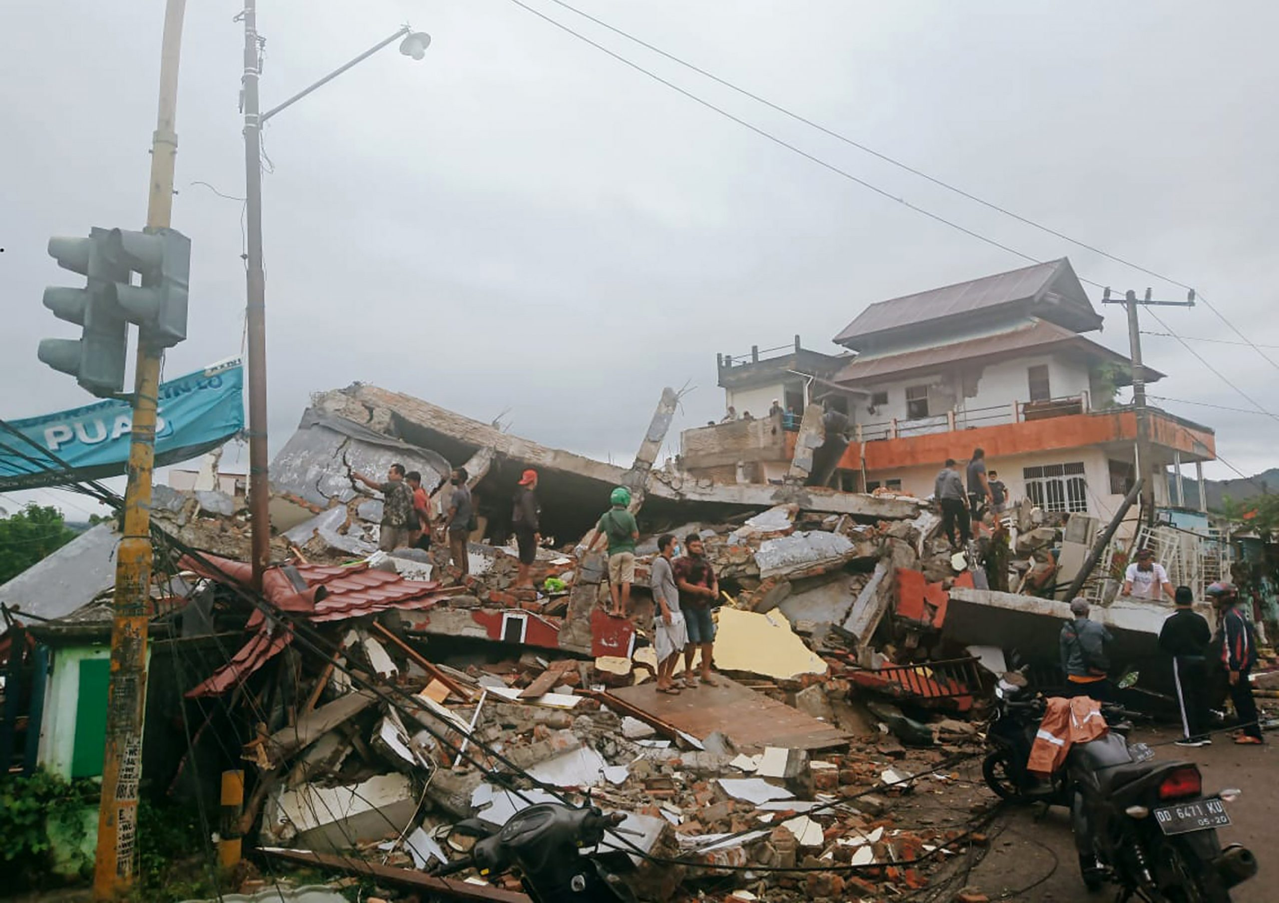 Earthquake triggers landslides, killing at least 3 in Indonesia